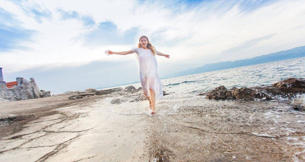 young-lady-enjoying-life-on-the-beach